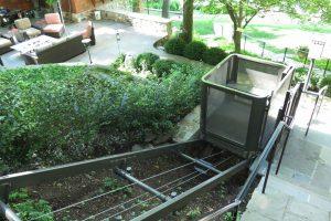 Hillside tram for patio access